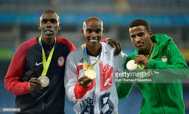 Silver medalist Paul Kipkemoi Chelimo of the United States gold medalist Mohamed Farah of Great Britain and bronze medalist Hagos Gebrhiwet of...