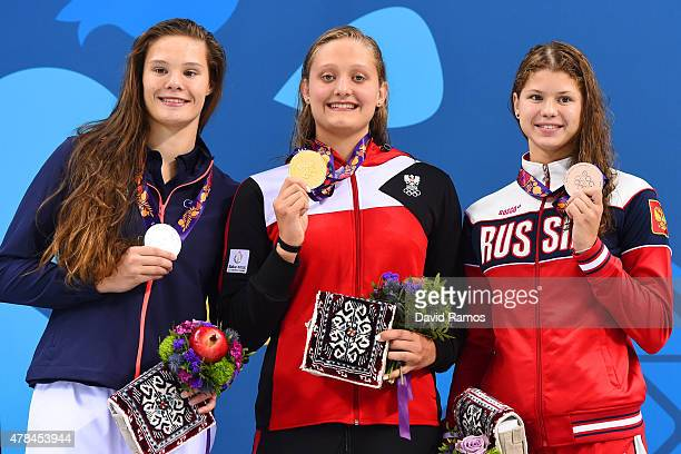 Silver medalist Pauline Mahieu of France gold medalist Caroline Pilhatsch of Austria and bronze medalist Mariia Kameneva of Russia stand on the...