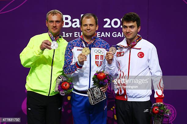 Silver medalist Pavol Kopp of Slovakia gold medalist Damir Mikec of Serbia and bronze medalist Abdullah Omer Alimoglu of Turkey pose with the medals...