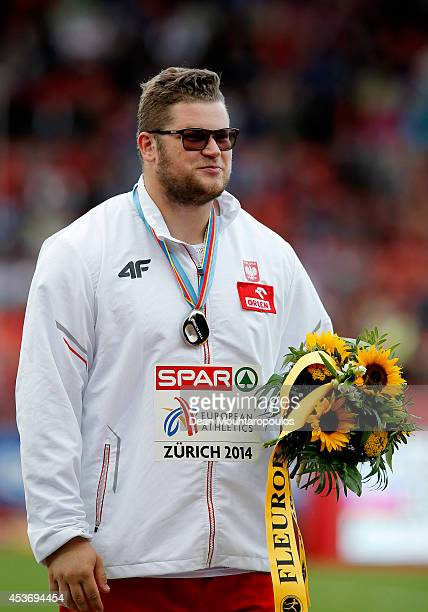 Silver medalist Pawel Fajdek of Poland celebrates on the podium during the medal ceremony for the Men's Hammer Throw Final during day five of the...