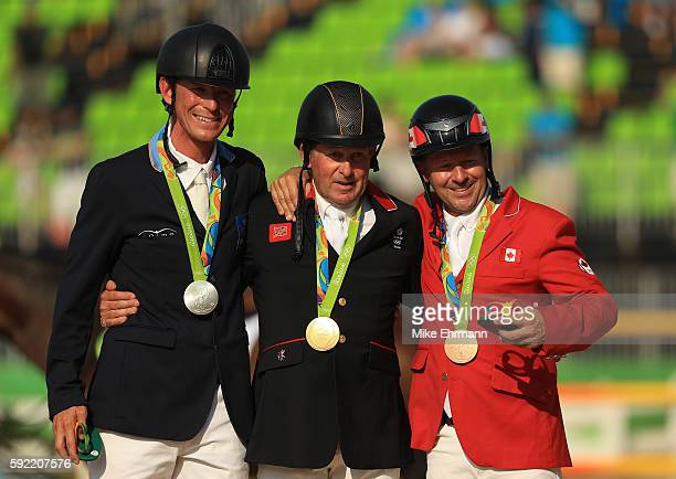 Silver medalist Peder Fredricson of Sweden riding All In, gold medalist Nick Skelton of Great Britain riding Big Star, and bronze medalist Eric...
