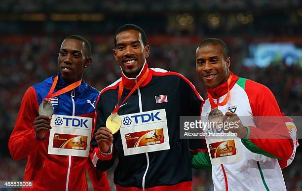 Silver medalist Pedro P Pichardo of Cuba gold medalist Christian Taylor of the United States and bronze medalist Nelson Evora of Portugal pose on the...
