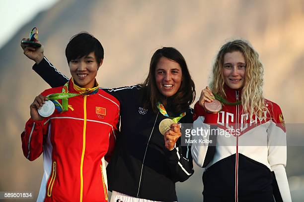 Silver medalist Peina Chen of China gold medalist Charline Picon of France and bronze medalist Stefaniya Elfutina of Russia celebrate on the podium...