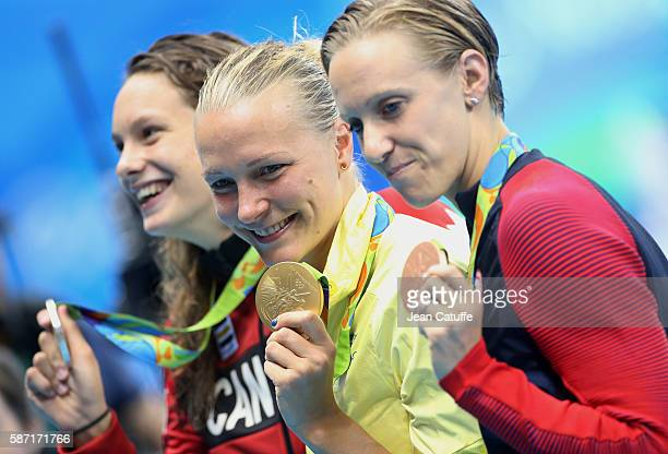 Silver medalist Penny Oleksiak of Canada gold medalist Sarah Sjostrom of Sweden and bronze medalist Dana Vollmer of USA pose during the medal...