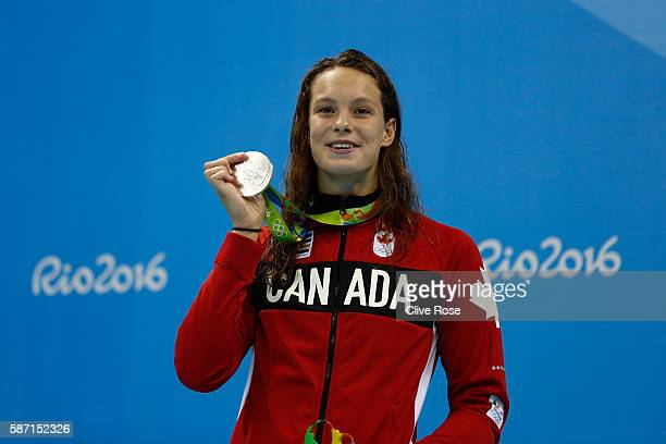 Silver medalist Penny Oleksiak of Canada poses on the podium during the medal ceremony for the Women's 100m Butterfly Final on Day 2 of the Rio 2016...