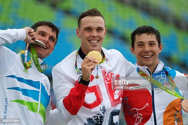 Silver medalist Peter Kauzer of Slovenia gold medalist Joseph Clarke of Great Britain and bronze medalist Jiri Prskavec of the Czech Republic...