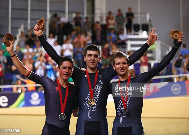 Silver medalist Peter Kennaugh of the Isle of Man gold medalist Tom Scully of New Zealand and bronze medalist Aaron Gate of New Zealand celebrate...