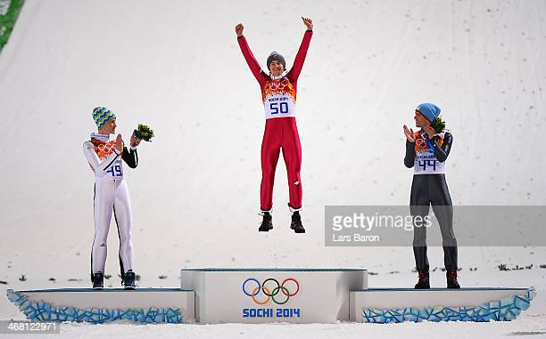 Silver medalist Peter Prevc of Slovenia gold medalist Kamil Stoch of Poland and bronze medalist Anders Bardal of Norway celebrate on the podium...