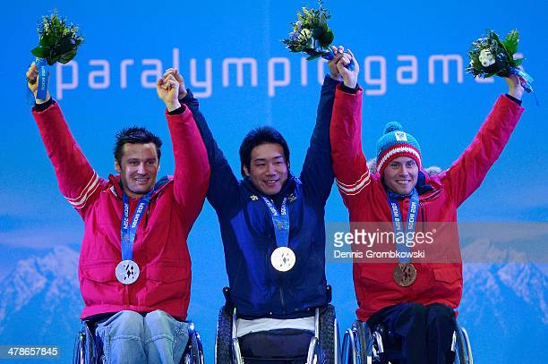 Silver medalist Philipp Bonadimann of Austria gold medalist Takeshi Suzuki of Japan and bronze medalist Roman Rabl of Austria celebrate at the medal...