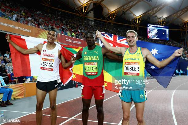 Silver medalist Pierce Lepage of Canada, gold medalist Lindon Victor of Grenada and bronze medalist Cedric Dubler of Australia celebrate after the...