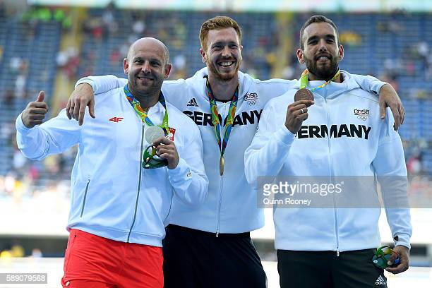 Silver medalist Piotr Malachowski of Poland Gold medalist Christoph Harting of German and Bronze medalist Daniel Jasinski of Germany celebrate on the...
