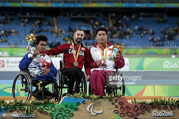 Silver medalist Pongsakorn Paeyo of Thailand gold medalist Brent Lakatos of Canada and bronze medalist Huzhao Li of China celebrate on the podium at...