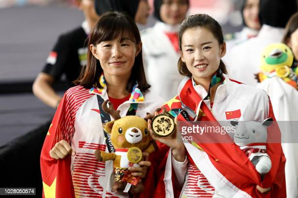 Silver medalist Qieyang Shijie of China and gold medalist Yang Jiayu of China pose with medals in Women's Athletics 20km Race Walk on day eleven of...