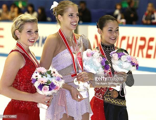 Silver medalist Rachael Flatt of the United States gold medalist Carolina Kostner of Italyand bronze medalist Kanako Murakami of Japan pose for...