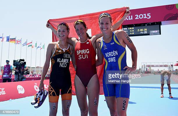 Silver medalist Rachel Klamer of Netherlands gold medalist Nicola Spirig of Switzerland and bronze medalist Lisa Norden of Sweden celebrate following...