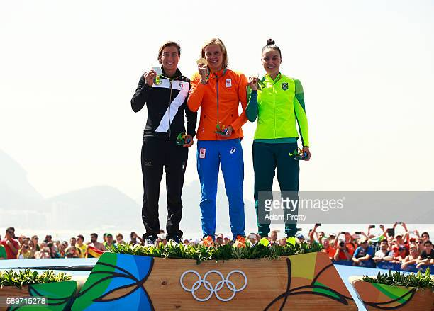 Silver medalist Rachele Bruni of Italy gold medalist Sharon van Rouwendaal of the Netherlands and bronze medalist Poliana Okimoto of Brazil pose on...