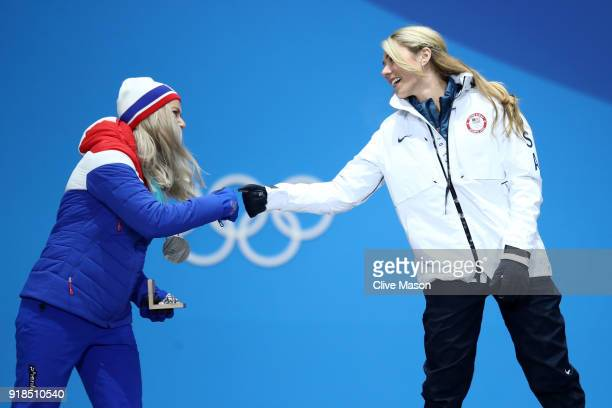 Silver medalist Ragnhild Mowinckel of Norway and gold medalist Mikaela Shiffrin of the United States greet each other during the medal ceremony for...