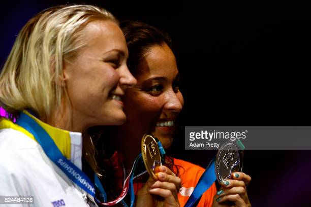 Silver medalist Ranomi Kromowidjojo of the Netherlands and gold medalist Sarah Sjostrom of Sweden pose with the medals won in the Women's 50m...