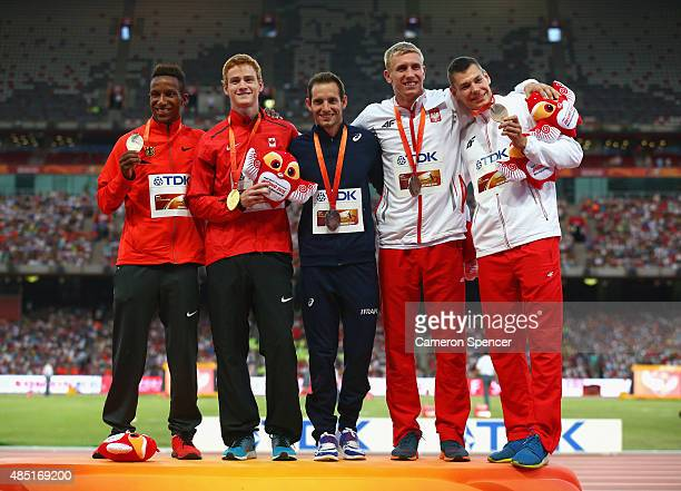 Silver medalist Raphael Marcel Holzdeppe of Germany gold medalist Shawnacy Barber of Canada and joint bronze medalists Renaud Lavillenie of France...