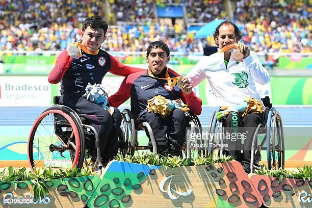 Silver medalist Raymond Martin of the USA gold medalist Gianfranco Iannotta of the USA and bronze medalist Salvador Hernandez Mondragon of Mexico...