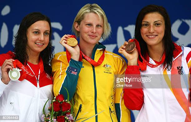 Silver medalist Rebecca Soni of the United States, gold medalist Leisel Jones of Australia and bronze medalist Mirna Jukic of Austria stand on the...