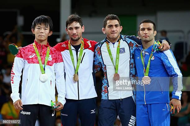 R] Silver medalist Rei Higuchi of Japan gold medalist Vladimer Khinchegashvili of Georgia bronze medalist Haji Aliyev of Azerbaijan and bronze...