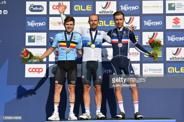 Silver medalist Remco Evenepoel of Belgium, gold medalist Sonny Colbrelli of Italy, and bronze medalist Benoit Cosnefroy of France, pose on the...