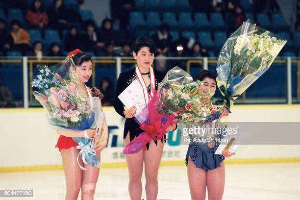 Silver medalist Rena Inoue gold medalist Yuka Sato and bronze medalist Kumiko Koiwai celebrate on the podium at the medal ceremony for the Women's...
