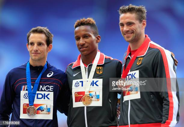 Silver medalist Renaud Lavillenie of France gold medalist Raphael Holzdeppe of Germany and bronze medalist Bjorn Otto of Germany stand on the podium...