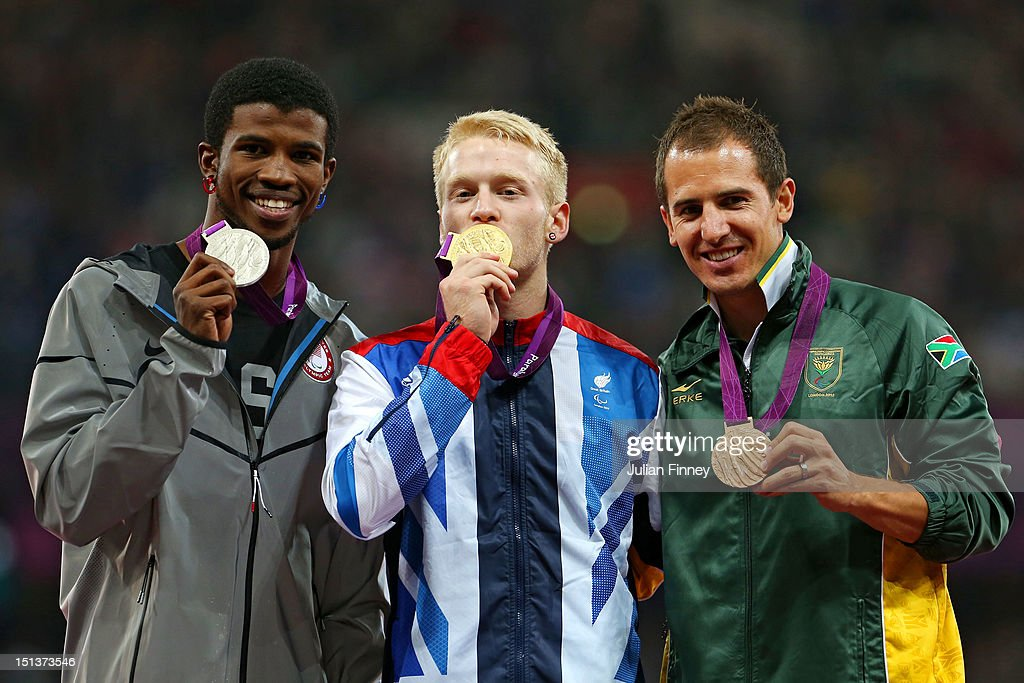 Silver medalist Richard Browne of the United States , Gold medalist Jonnie Peacock of Great Britain, Bronze medalist Arnu Fourie of South Africa pose on the podium during the victory ceremony for the Men's 100m - T44 Final on day 8 of the London 2012 Paralympic Games at Olympic Stadium on September 6, 2012 in London, England.