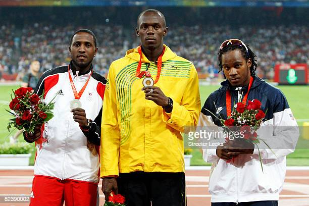 Silver medalist Richard Thompson of Trinidad and Tobago gold medalist Usain Bolt of Jamaica and bronze medalists Walter Dix of the United States...