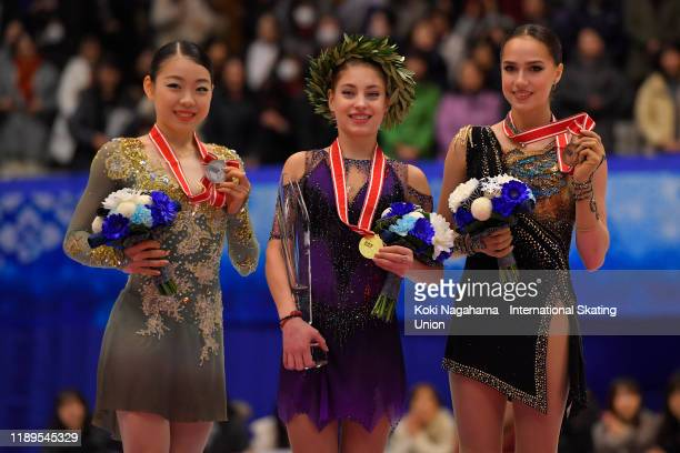 Silver medalist Rika Kihira of Japan Gold medalist Alena Kostornaia of Russia and Bronze medalist Alina Zagitova of Russia pose for photographs on...