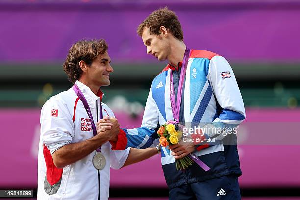 Silver medalist Roger Federer of Switzerland congratulates gold medalist Andy Murray of Great Britain during the medal ceremony for the Men's Singles...