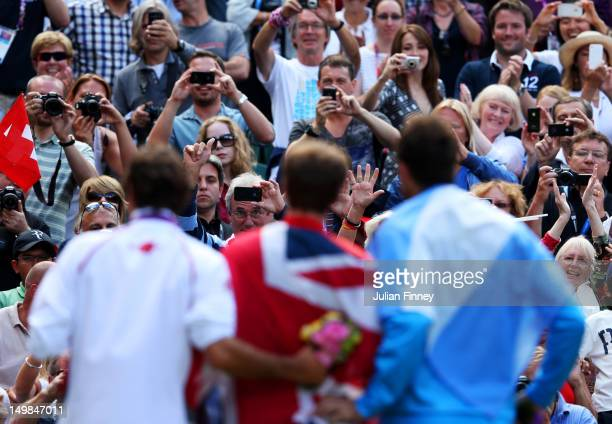 Silver medalist Roger Federer of Switzerland gold medalist Andy Murray of Great Britain and bronze medalist Juan Martin Del Potro of Argentina pose...