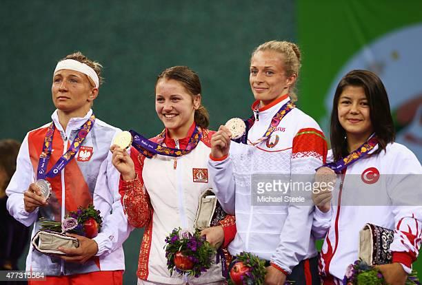 Silver medalist Roksana Zasina of Poland, gold medalist Anzhela Dorogan of Azerbaijan and bronze medalists Nadzeya Shushko of Belarus and Merve...