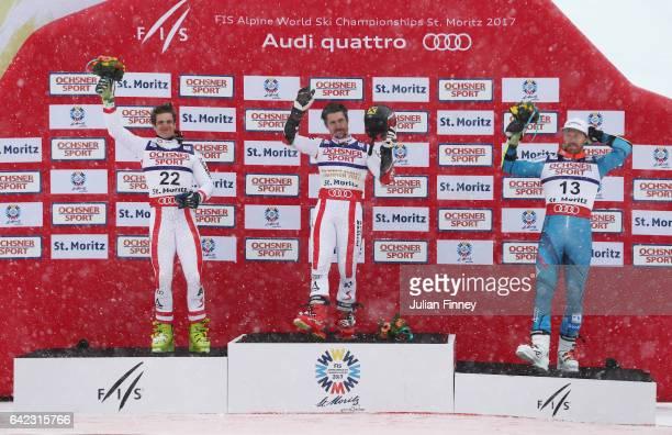 Silver medalist Roland Leitinger of Austria gold medalist Marcel Hirscher of Austria and bronze medalist Leif Kritian Haugen of Norway celebrate on...