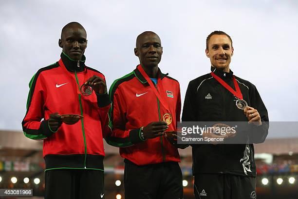 Silver medalist Ronald Kwemoi of Kenya, gold medalist Jovanee Jarrett of Jamaica James Kiplagat Magut of Kenya and bronze medalist Nick Willis of New...