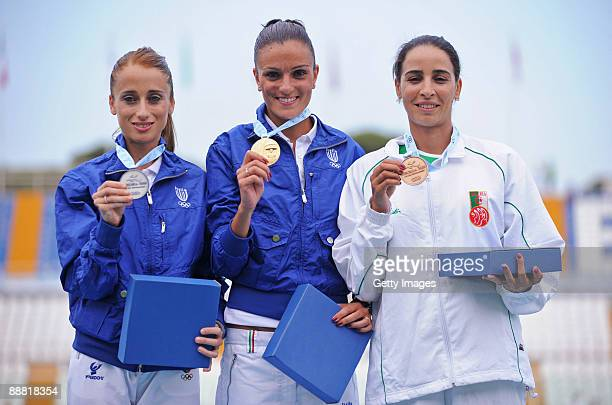 Silver medalist Rosaria Console of Italy gold medalist Anna Incerti of Italy and bronze medalist Kenza Dahmani Eps Tifani pose for the photographers...