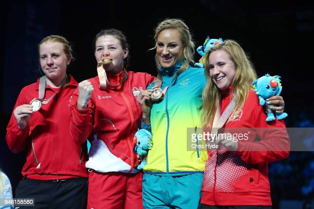 Silver medalist Rosie Eccles of Wales Gold medalist Sandy Ryan of England Bronze medalists Kaye Scott of Australia and MarieJeanne Parent of Canada...