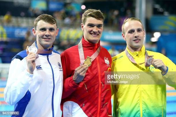 Silver medalist Ross Murdoch of Scotland gold medalist James Wilby of England and bronze medalist Matt Wilson of Australia pose during the medal...
