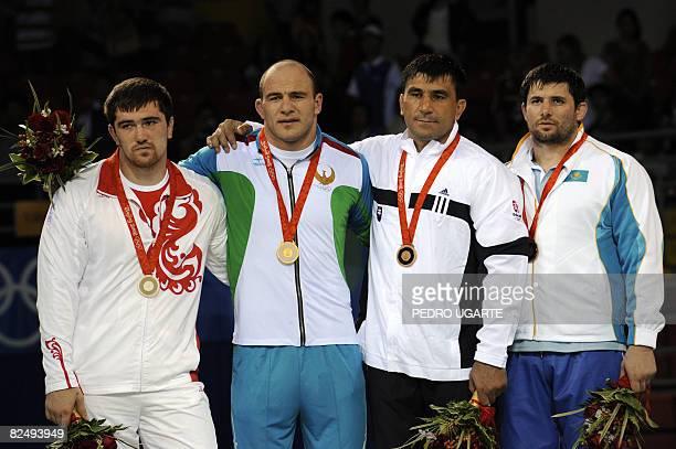 Silver medalist Russia's Bakhtiyar Akhmedov gold medalist Uzbekistan's Artur Taymazov and bronze medalists Slovakia's David Musulbes and Kazakhstan's...