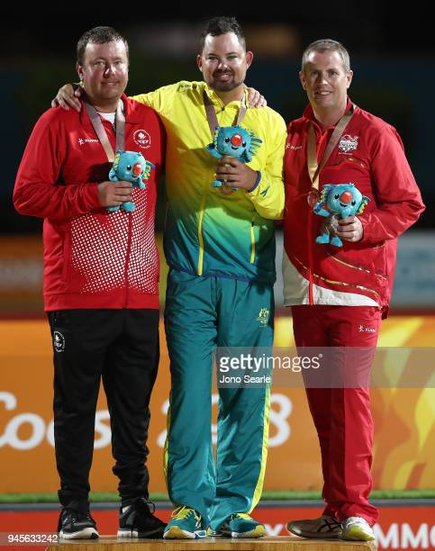 Silver medalist Ryan Bester of Canada Gold medalist Aaron Wilson of Australia and bronze medalist Robert Paxton of England pose during the medal...