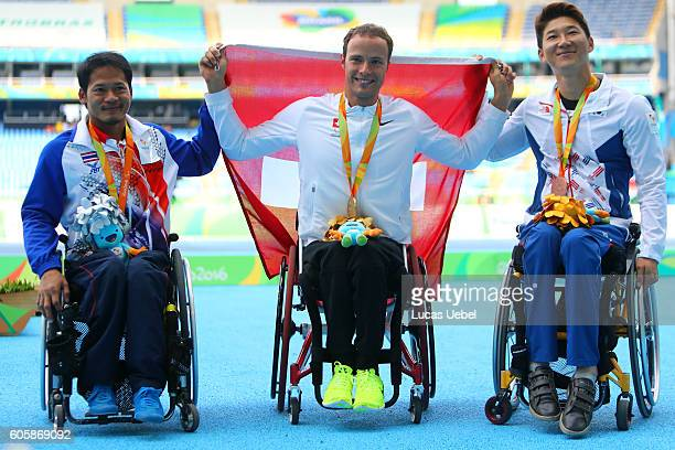 Silver medalist Saichon Konjen of Thailand gold medalist Marcel Hug of Swiss and bronze medalist Gyu Dae Kim of South Korea pose on the podium at the...
