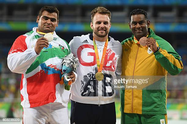 Silver medalist Sajad Mohammadian of Iran Gold medalist Aled Davies of Great Britain and Bronze medalist Tyrone Pillay of South Africa celebrate on...