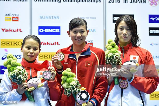 Silver medalist Sakiko Shimizu of Japan and Gold medalist Nguyen Thi Anh Vien of Vietnam and Bronze medalist Yui Ohashi of Japan pose for photographs...