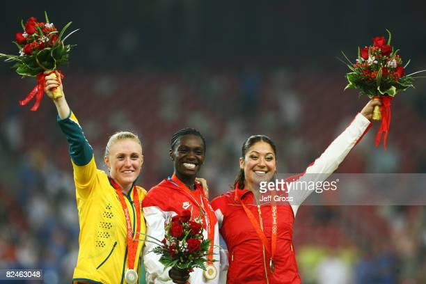 Silver medalist Sally McLellan of Australia gold medalist Dawn Harper of the United States and bronze medalist Priscilla LopesSchliep of Canada stand...