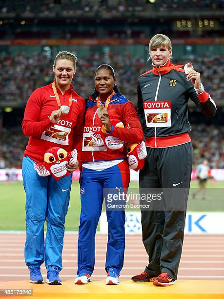 Silver medalist Sandra Perkovic of Croatia gold medalist Denia Caballero of Cuba and bronze medalist Nadine Muller of Germany pose during the medal...