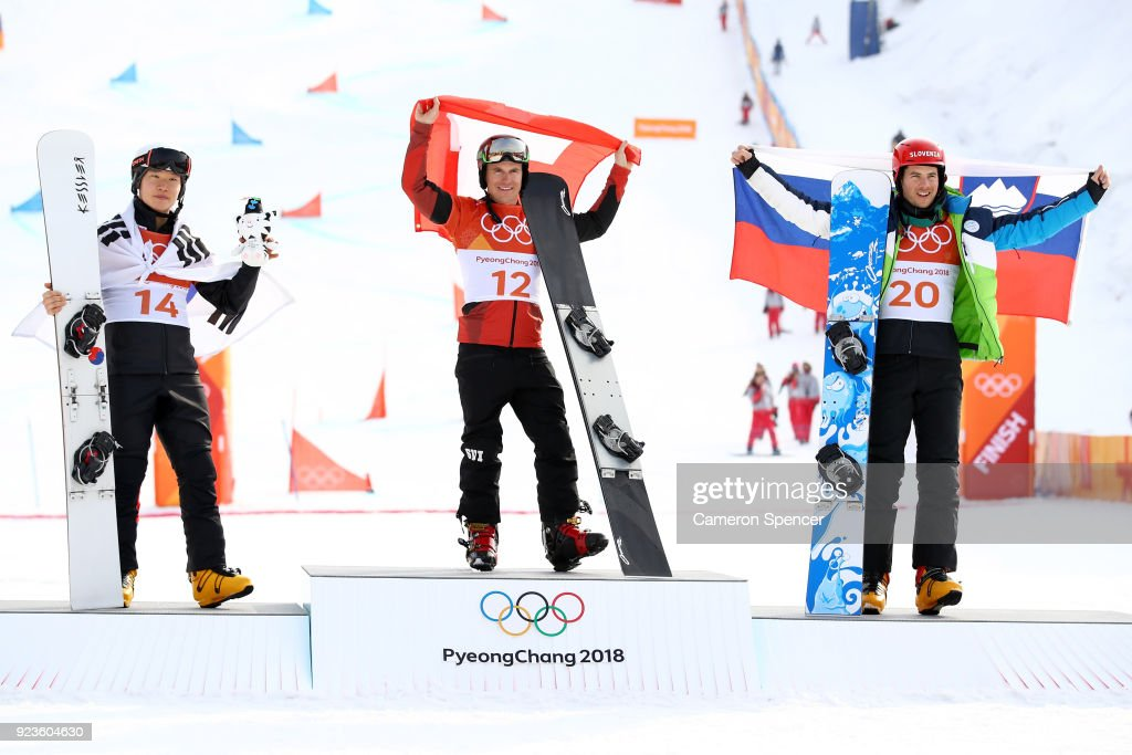 Silver medalist Sang-ho Lee of Korea, gold medalist Nevin Galmarini of Switzerland and bronze medalist Zan Kosir of Slovenia pose during the victory ceremony for the Men's Snowboard Parallel Giant Slalom on day fifteen of the PyeongChang 2018 Winter Olympic Games at Phoenix Snow Park on February 24, 2018 in Pyeongchang-gun, South Korea.
