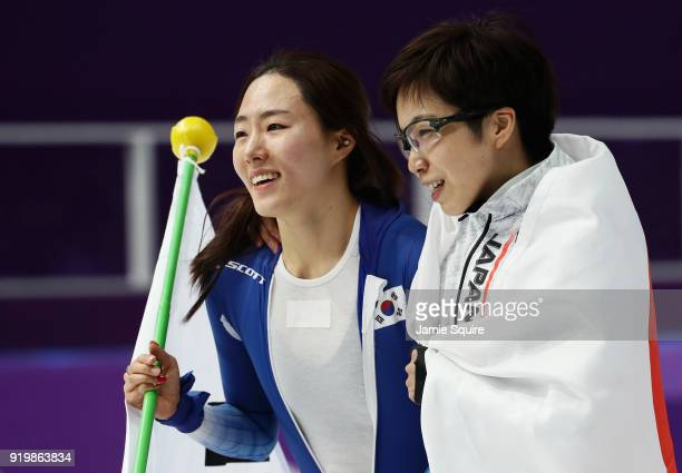 Silver medalist SangHwa Lee of Korea and gold medalist Nao Kodaira of Japan celebrate after the Ladies' 500m Individual Speed Skating Final on day...