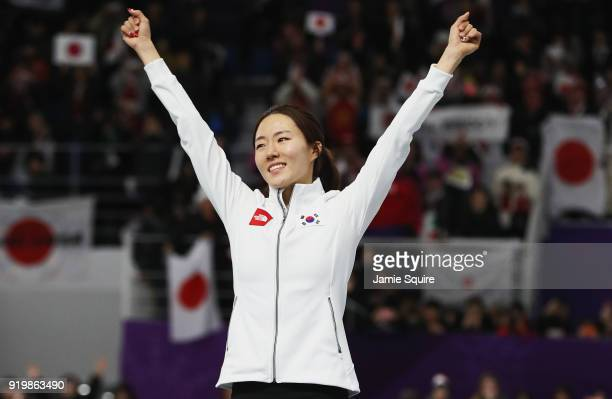 Silver medalist SangHwa Lee of Korea celebrates during the victory ceremony after the Ladies' 500m Individual Speed Skating Final on day nine of the...